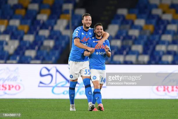 Dries Mertens of Napoli celebrates with team mate Amir Rrahmani after scoring their side's first goal during the Serie A match between SSC Napoli and...