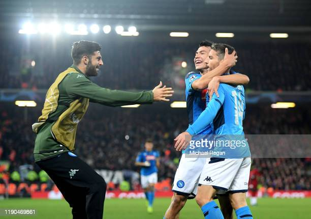 Dries Mertens of Napoli celebrates with teammates after scoring his team's first goal during the UEFA Champions League group E match between...