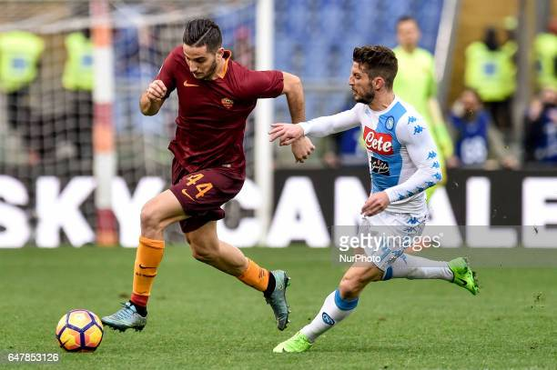 Dries Mertens of Napoli challenges Konstantinos Manolas of AS Roma during the Serie A match between Roma and Napoli at Stadio Olimpico Rome Italy on...