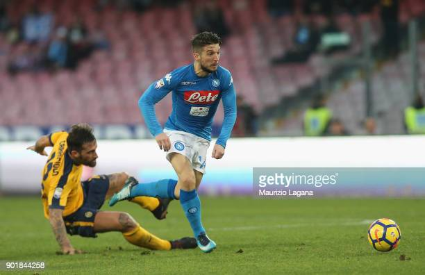 Dries Mertens of Napoli competes for the ball with Anotinio Caracciolo of Hellas Verona during the serie A match between SSC Napoli and Hellas Verona...