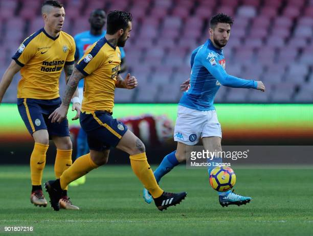 Dries Mertens of Napoli competes for the ball with Antonio Caracciolo of Hellas Verona during the serie A match between SSC Napoli and Hellas Verona...