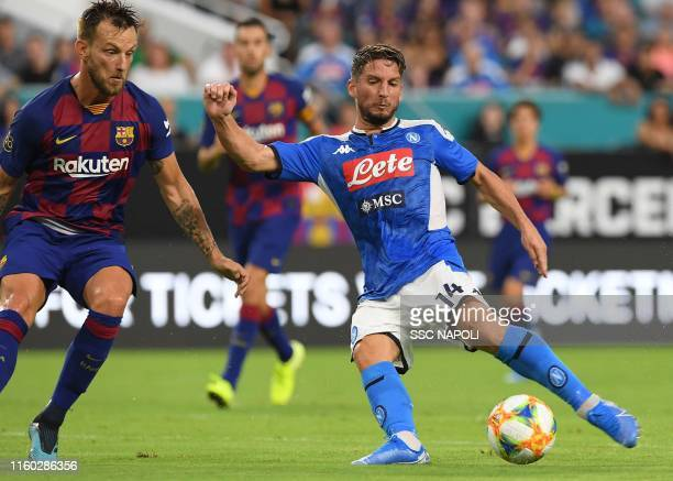 Dries Mertens of Napoli kicks the ball against Ivan Rakitic of Barcelona during the preseason friendly match between FC Barcelona and SSC Napoli at...
