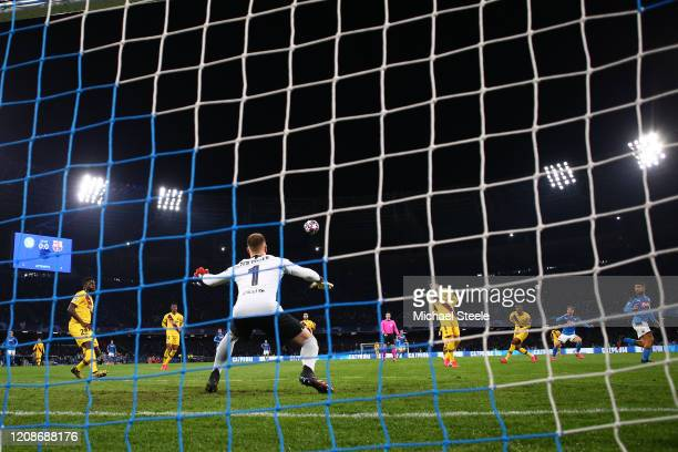 Dries Mertens of Napoli scores the opening goal during the UEFA Champions League round of 16 first leg match between SSC Napoli and FC Barcelona at...