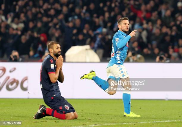 Dries Mertens of SSC Napoli celebrates after scoring the 32 goal beside the disappointment of Danilo of Bologna FC during the Serie A match between...