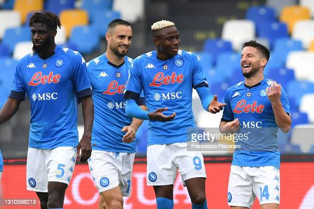 Dries Mertens of SSC Napoli celebrates with team mate Victor Osimhen after scoring their side's third goal during the Serie A match between SSC...