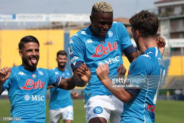 Dries Mertens of SSC Napoli celebrates with team mates after scoring to give the side a 1-0 lead during the Serie A match between Parma Calcio and...