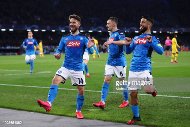 Dries Mertens of SSC Napoli celebrates with teammates Mario Rui and Lorenzo Insigne of SSC Napoli after scoring his teams first goal during the UEFA...