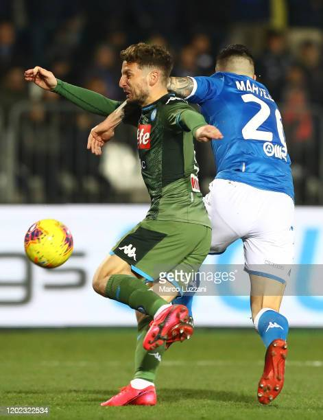 Dries Mertens of SSC Napoli competes for the ball with Bruno Martella of Brescia Calcio during the Serie A match between Brescia Calcio and SSC...