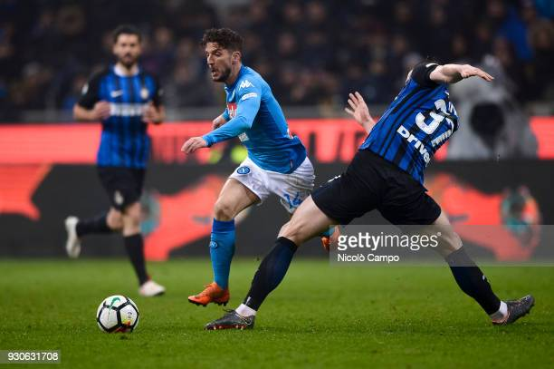 Dries Mertens of SSC Napoli competes for the ball with Milan Skriniar of FC Internazionale during the Serie A football match between FC...