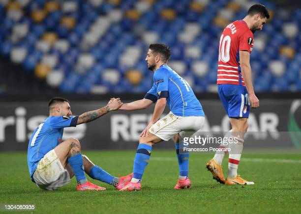 Dries Mertens of SSC Napoli helps Matteo Politano of SSC Napoli to his feet during the UEFA Europa League Round of 32 match between SSC Napoli and...