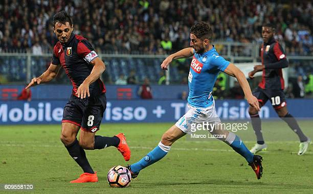 Dries Mertens of SSC Napoli is challenged by Nicolas Andres Burdisso of Genoa CFC during the Serie A match between Genoa CFC and SSC Napoli at Stadio...