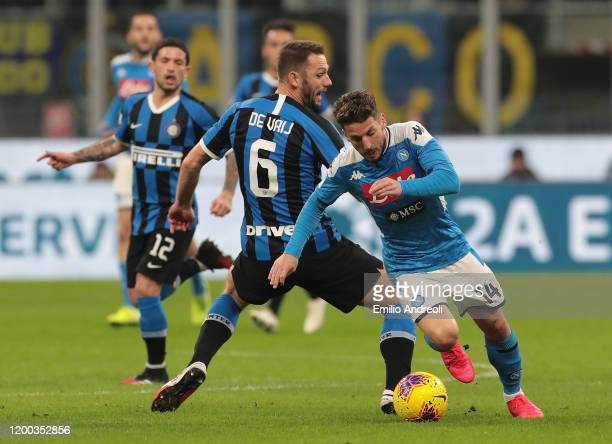 Dries Mertens of SSC Napoli is challenged by Stefan De Vrij of FC Internazionale during the Coppa Italia Semi Final match between FC Internazionale...