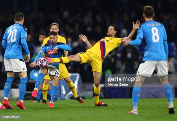 Dries Mertens of SSC Napoli is fouled by Sergio Busquets of FC Barcelona during the UEFA Champions League round of 16 first leg match between SSC...