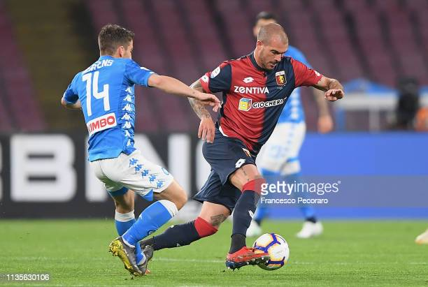 Dries Mertens of SSC Napoli vies Davide Biraschi of Genoa CFC during the Serie A match between SSC Napoli and Genoa CFC at Stadio San Paolo on April...