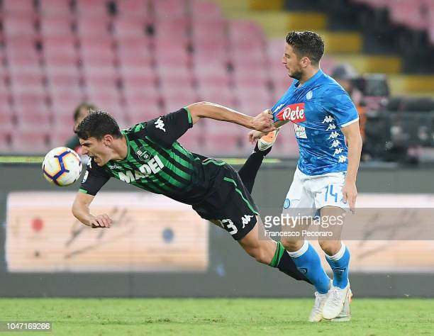Dries Mertens of SSC Napoli vies Giangiacomo Magnani of US Sassuolo during the Serie A match between SSC Napoli and US Sassuolo at Stadio San Paolo...