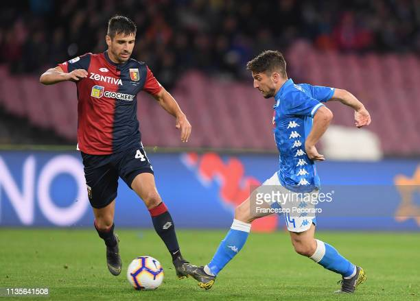 Dries Mertens of SSC Napoli vies Miguel Veloso of Genoa CFC during the Serie A match between SSC Napoli and Genoa CFC at Stadio San Paolo on April 7...