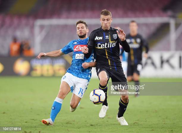 Dries Mertens of SSC Napoli vies Simone Iacoponi of Parma Calcio during the serie A match between SSC Napoli and Parma Calcio at Stadio San Paolo on...