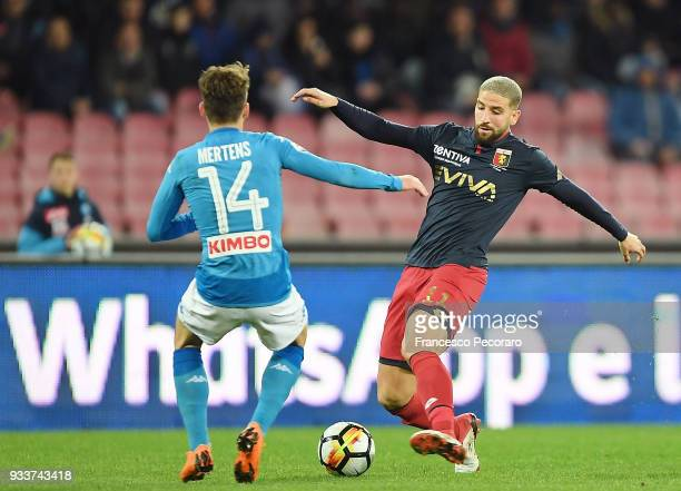 Dries Mertens of SSC Napoli vies with Adel Taarabt of Genoa CFC during the serie A match between SSC Napoli v Genoa CFC at Stadio San Paolo on March...