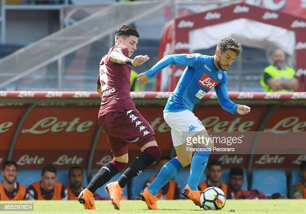 Dries Mertens of SSC Napoli vies with Daniele Baselli of Torino FC during the serie A match between SSC Napoli and Torino FC at Stadio San Paolo on...