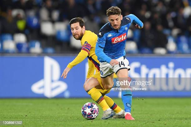Dries Mertens of SSC Napoli vies with Lionel Messi of FC Barcelona during the UEFA Champions League round of 16 first leg match between SSC Napoli...