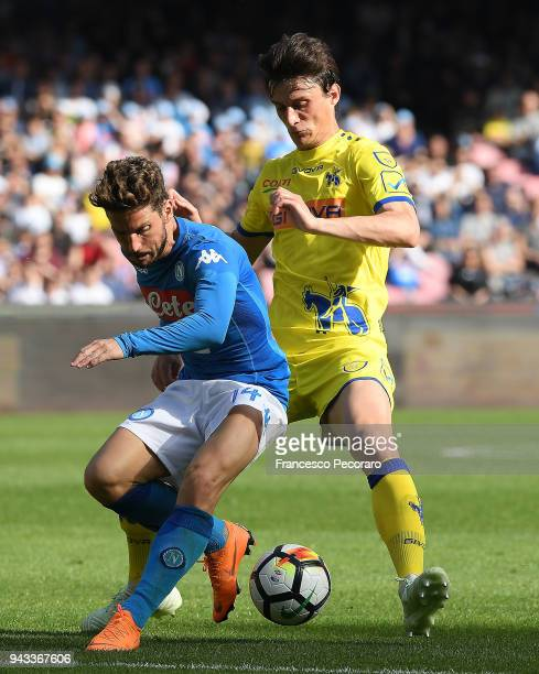 Dries Mertens of SSC Napoli vies with Roberto Inglese of AC Chievo Verona during the serie A match between SSC Napoli and AC Chievo Verona at Stadio...
