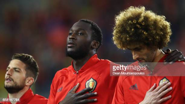 Dries Mertens Romelu Lukaku and Marouane Fellaini of Belgium stand for the national anthem prior to the FIFA 2018 World Cup Group H Qualifier match...