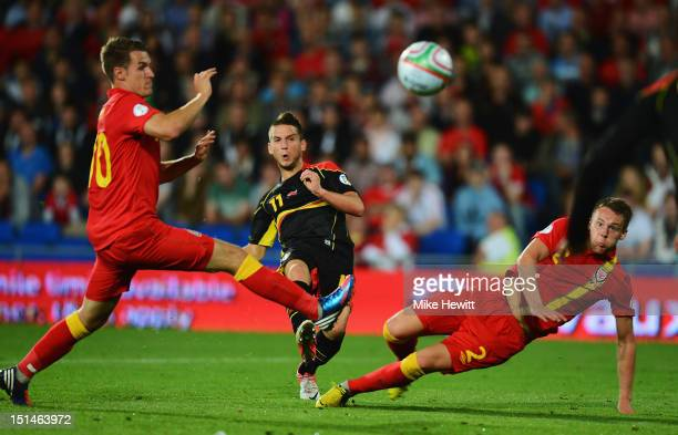 Dries Mertens shoots at goal despite the efforts of Aaron Ramsey and Chris Gunter of Wales during the FIFA 2014 World Cup Group A Qualifier between...