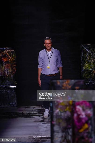 Dries Van Noten walks the runway during the Dries Van Noten show as part of the Paris Fashion Week Womenswear Spring/Summer 2017 on September 28 2016...