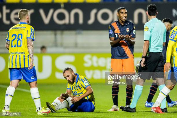 Driess Saddiki of Willem II discusses with referee Dennis Higler during the Dutch Eredivisie match between RKC Waalwijk and Willem II at Mandemakers...