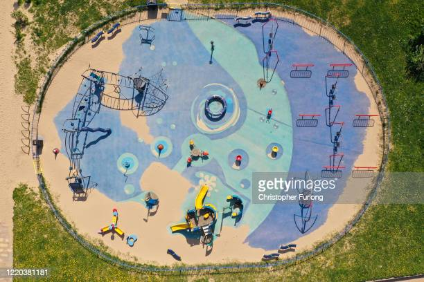 Drifting sand begins to take over a children's park during the pandemic lockdown on April 22, 2020 in Rhyl, Wales. The British government has...