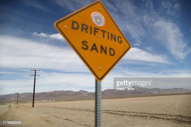 A 'Drifting Sand' sign is posted in the Mojave desert on September 22 2019 in Amboy California California's Fourth Climate Change Assessment found...