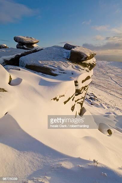 Drifting snow on White Tor, Derwent Edge, Derwent Moor, Peak District National Park, Derbyshire, England, United Kingdom