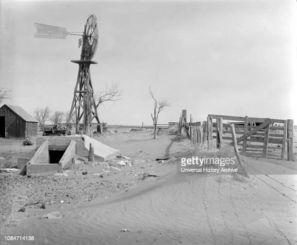 Drifting Soil in Farmyard, Hartley County, Texas, USA, Arthur Rothstein, Farm Security Administration, April 1936.