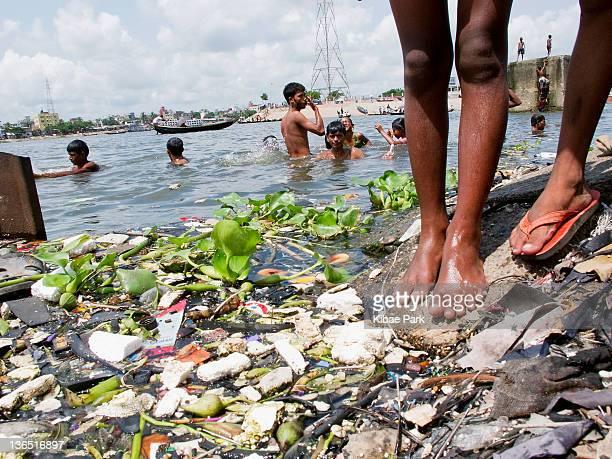 Drifting waste on the Buriganga river in Dhaka, Bangladesh