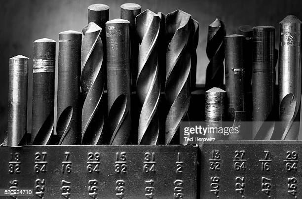 drill bits, black and white still life. - drill stock pictures, royalty-free photos & images