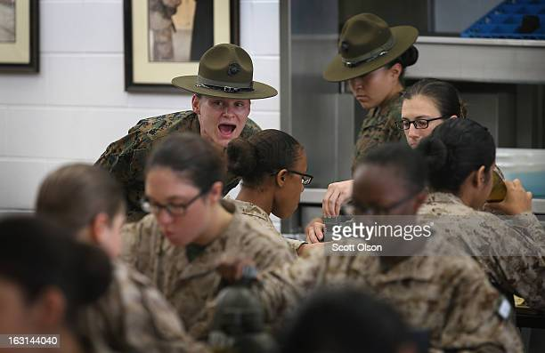 Drill Instructor Sgt Chasitie Chambers from Bear Delaware speaks to her female Marine recruits in the chow hall during boot camp February 26 2013 at...