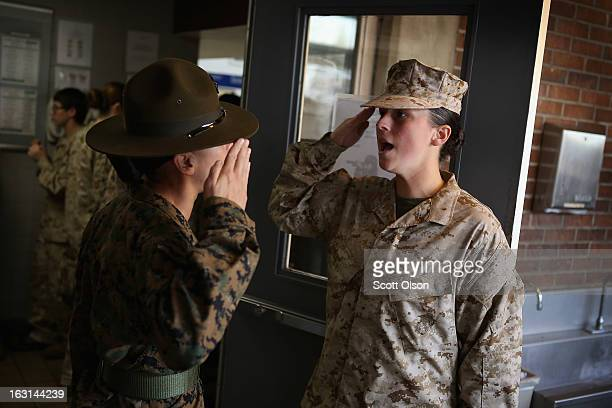 Drill Instructor SSgt Angela Lopez teaches Marine Recruit Ashley Florence how to properly salute while waiting in line at the chow hall during boot...