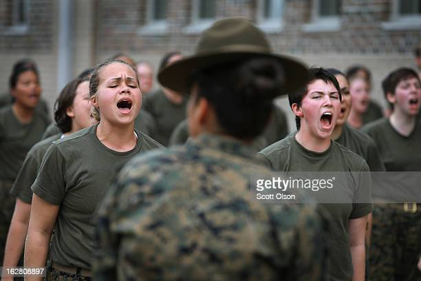 Drill Instructor SSgt Jennifer Garza disciplines her Marine recruits with some unscheduled physical training in the sand pit outside their barracks...