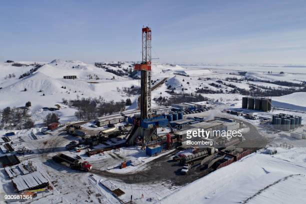 A drill rig stands above an oil well in the Bakken Formation in this aerial photograph taken outside Williston North Dakota US on Thursday March 8...