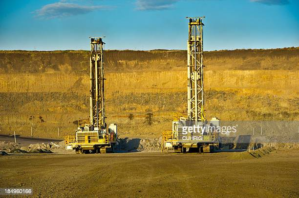 Drill rigs on mine site preparing blast