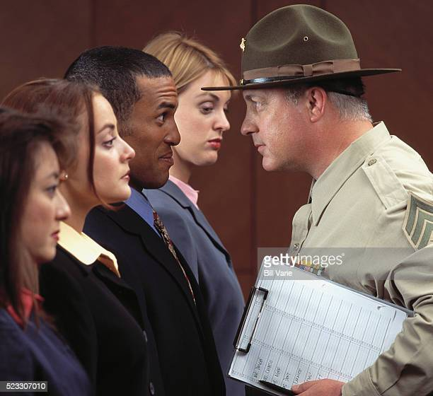 Drill Sergeant Inspecting Office Workers