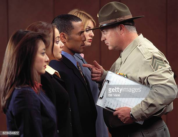 Drill Sergeant Pointing at Office Workers