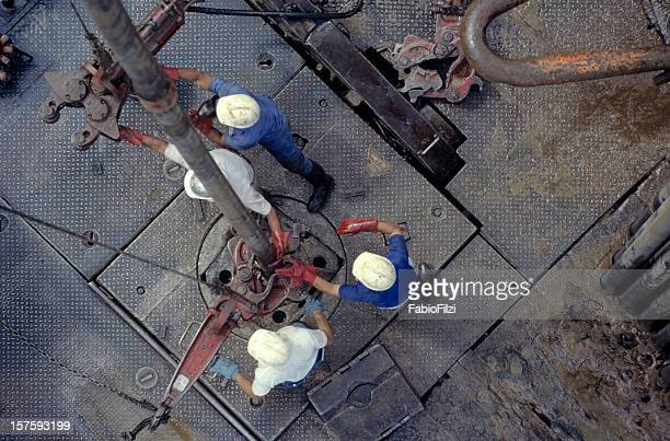 drill workers - oil industry stock pictures, royalty-free photos & images