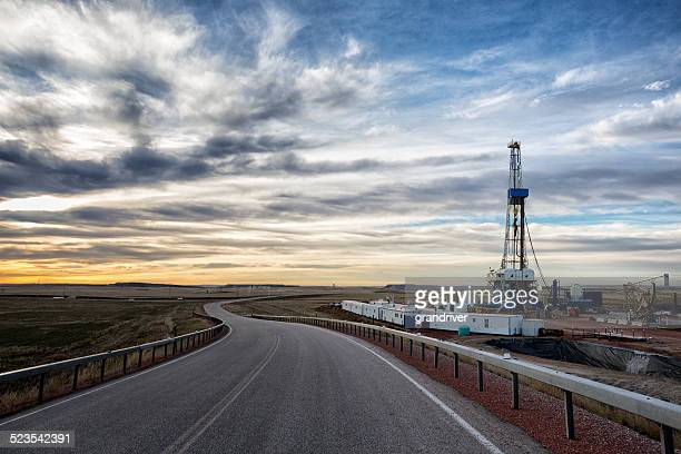 drilling fracking rig at sunrise - fracking stock pictures, royalty-free photos & images