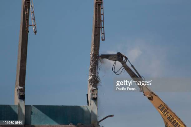 Drilling machine working over the stands of Vicente Calderon. The demolition of the last stand of the formerly fifty five thousand seat capacity...