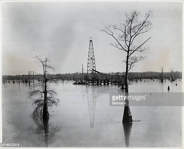 Drilling over water has come a long way too Here is the first sucessful marine effort This is a 1910 scene at Lake Caddo in Louisiana The crew boats...