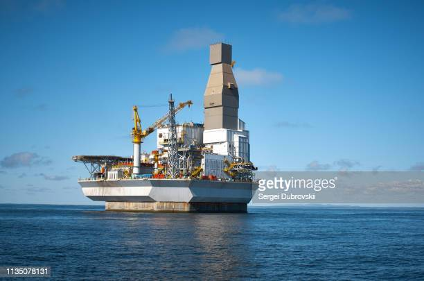 drilling rig offshore area, sea and clean blue sky - sea of okhotsk stock pictures, royalty-free photos & images