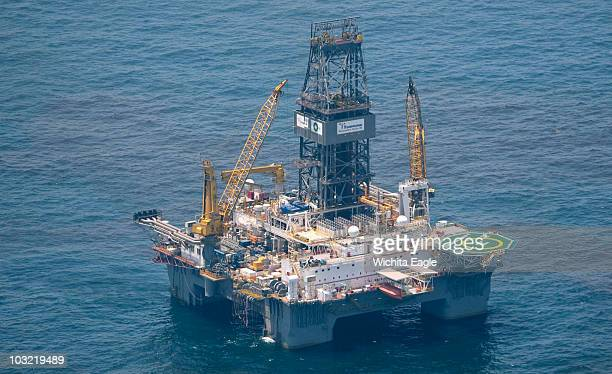 A drilling rig sitting where a Deepwater Horizon drilling rig exploded on April 20 continues to try and plug a massive oil leak that was created by...
