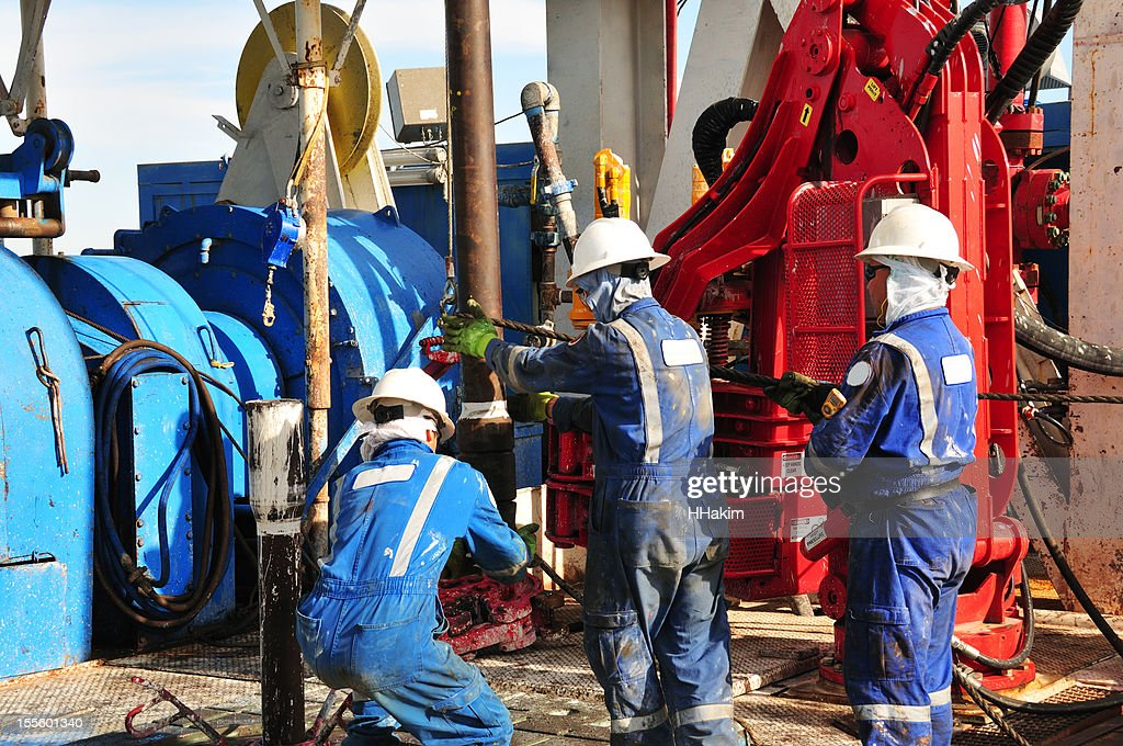 Drilling rig workers : Stock Photo