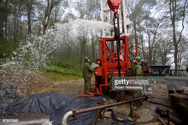 A drilling team from Minard Run Oil Company pull out steel pipe during a fracing operation at a 2100 foot natural gas well in Pleasant Valley...